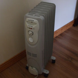 How much energy does a portable, oil filled space heater use?